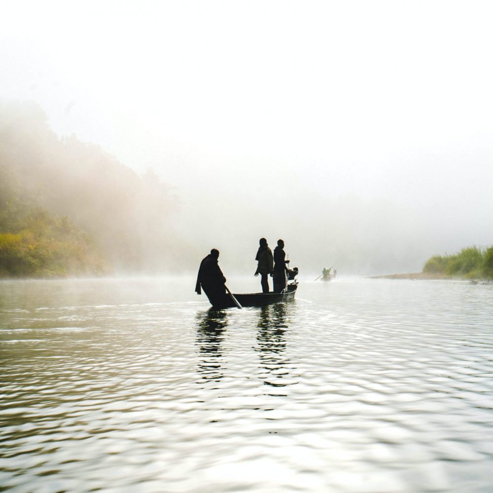 A foggy winter morning of fisherman on the Sangu river.